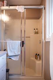 one piece shower stalls with seats corner and fiberglass sliding door ideas