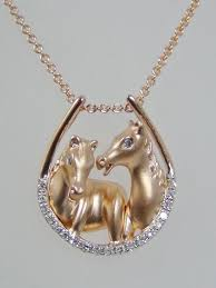 rose gold diamond horse shoe necklace with rose gold horses lindas jewelry