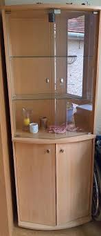 display cabinet with double top glass doors shelves and double cupboard with shelves