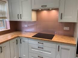 rose gold glass kitchen splashback
