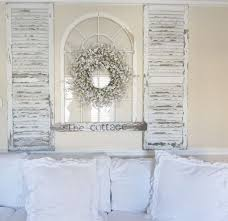 simple window shutter wall decor for 7 inspiring ways to use vintage shutters on your walls