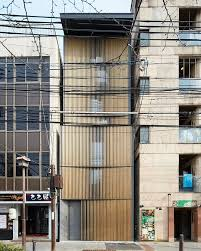 office facade. florian busch disguises eight storey nightlife venue in kyoto with louvered timber faade architecture officecontemporary office facade 2