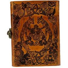 hand tooled blank leather journal with heavily embossed covers showing fo leaves and knot work