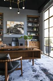 masculine home office. The Owner\u0027s Home Office Has Custom Brass And Walnut Built-ins That House A Collection Of Machine Parts. Walls Are Upholstered In Grayish Blue Flannel, Masculine U