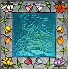 technique embossed horse 9 x9 stained glass fl border panel with a colored glass