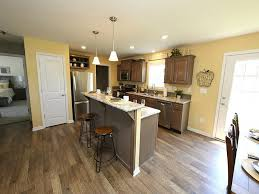 great kitchen with island and open living concept to dining area in the drake a