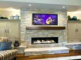 mounting tv above gas fireplace mount for stone fireplace shelving ideas beside stone fireplace with above