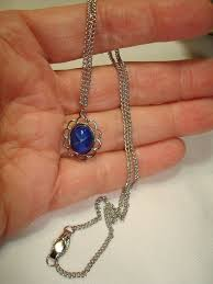 blue star sapphire pendant on a silver