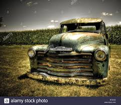 vintage chevrolet truck logo. stock photo vintage chevy truck planted in the ground outdoors under hot sun chevrolet logo t