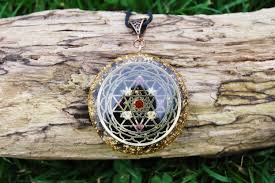 orgone pendant 24k gold sri yantra iron oxide core rainbow moonstone and amethyst grid herkimer shungite selenite sacred geometry orgonite pendant