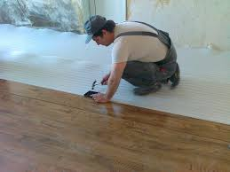 installing laminate flooring. Stacked Laminate With A Hammer Installing Flooring