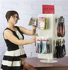 countertop pegboard display with white hooks spinner
