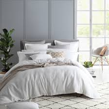 pictured private collection fitzroy white duvet cover set matched with other neutral coloured accessories and coordinating european pillowcase and cushion