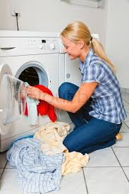washing clothes in washing machine. a young housewife with washing machine and clothes. day. | stock photo colourbox clothes in d