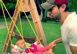 cute enrique iglesias showed off his affection for the infants in a he posted