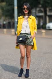 yellow peacoat by teaming it with cream white blouse and patterned mini shorts i am so in love with suede pointed toe ankle boots in navy color