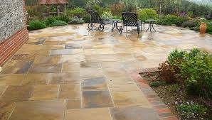 natural stone patio with garden furniture
