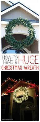 How To Hang Lighted Wreath On Door How To Hang A Giant Outdoor Christmas Wreath Ella Claire