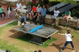 an intense game of ping pong on our cantilever outdoor table