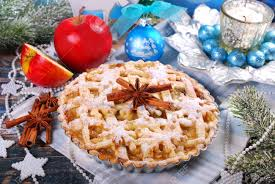 Homemade Christmas Apple Pie And Decorations On Festive Table Stock