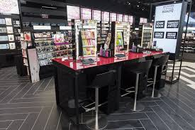 a section of the beauty hub with its beauty tip stations equipped with touch screen tablets sephora