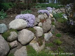 Granite Wall granite boulder retaining wall with sedum plantings nestled in the 7591 by xevi.us