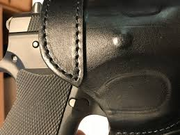 it does not feel bulky like a kydex holster which retains it shape putting the pistol back in it is no problem with the falco s reinforced mouth as shown