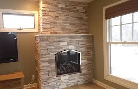 we recently installed this mendota fv34 arch fireplace in edina mn the surrounding stone is a casa blend 3d multi finish travertine