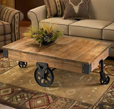 Hand-crafted, plank-style table with wheels has the look of an old. Rustic  Coffee ...
