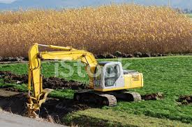 drainage ditch excavator with bucket widening drainage ditch stock photos