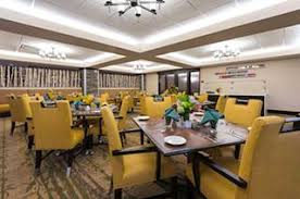 The Cottonwood Place Senior Living dining room features biophilic design.