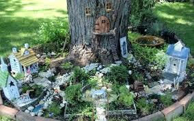 how to make a fairy garden fairy garden set at the bottom of a tree fairy how to make a fairy garden