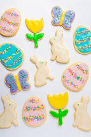overhead shot of frosted sugar cookies decorated for easter