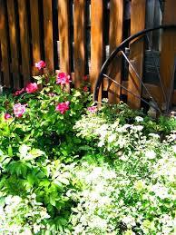 flower garden wagon wagon wheel garden vintage antique flower bed summer spring garden flower cart planter flower garden wagon
