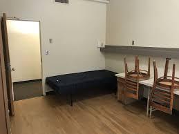 parker hall bedroom after remodel view of room door bed and desk area