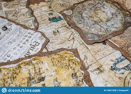 Old Nautical Charts Laid Out On The Table Stock Image