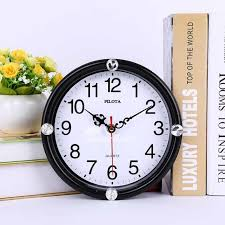 pictures show small wall clocks round
