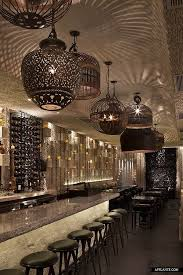 mix of lighting shapes shadows on ceiling palmilla restaurant hermosa beach california by g design