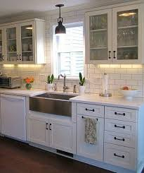 over the sink lighting. Apron Sink, Back Splash Love The Dark Wood Floors With Two Colors Of Cabinetry, Glass Upper Cabinets, And White Black Appliances Countertops. Over Sink Lighting