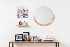 the ideal space between a mirror and the furniture below it is six to eight inches if your furniture is approximately 35 inches high