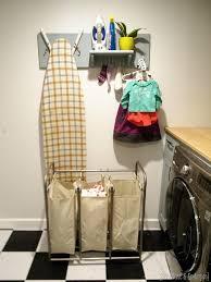diy laundry room organizer holds ironing board iron unmatched socks