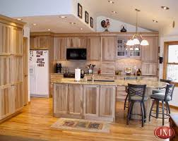 Custom kitchen natural pecan wood cabinets, hardwood floors and eating space