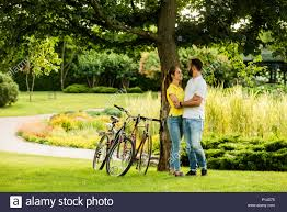 young caucasian cyclists hugging on summer nature background best travel ever