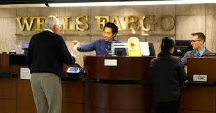it take another quarter or two for growth rate to pick up tellers serve customers at the wells fargo bank in downtown denver