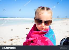 cool beach towels for girls. Little Girl Wrapped In A Colorful Beach Towel And Wearing Sunglasses Sitting At The Ocean Cool Towels For Girls