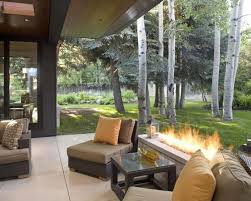 outside fireplaces ideas and inspirations to improve your outdoor. Modern Fireplace In Luxurious Backyard Patio Ideas With Cozy Sofa Near Small Table Outside Fireplaces And Inspirations To Improve Your Outdoor