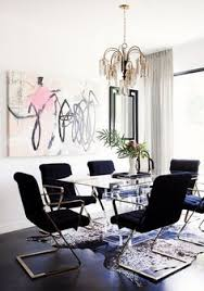 love the mid century elements in this dining room especially the black z chairs charming pernk dining room