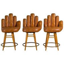 set of three leather baseball glove swivel bar stools signed