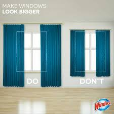 make small windows appear larger by hanging long and wide curtains