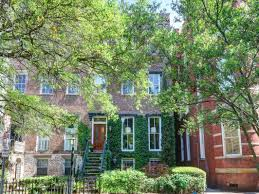 An ivy-covered brick exterior, tall rooms full of natural light, and an